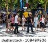 PARIS, JUL 22: The official mobile shop of Le Tour de France is parked on the Champs Elysees boulevard in Paris. It sells specific souvenirs during the last stage of Le Tour de France on 22 July 2012 - stock photo