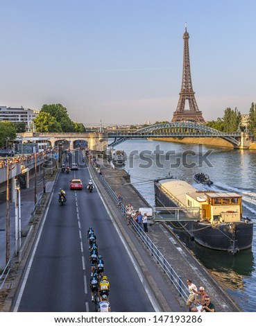 PARIS,JUL 21: The Sky Team with Chris Froome in Yellow Jersey riding on the Seine riverside near the Eiffel Tower in the last stage of the 100 edition of Le Tour de France on July 21, 2013 in Paris - stock photo