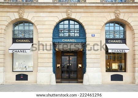 PARIS - JULY 8: Chanel shop in place Vendome in Paris. Chanel is a fashion house founded in 1909 specialized in haute couture and luxury goods, on July 8, 2014 in Paris. - stock photo