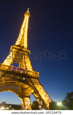 PARIS - JULY 20 : Eiffel tower at night on July 20, 2010 in Paris. The Eiffel tower is the most visited monument of France. - stock photo