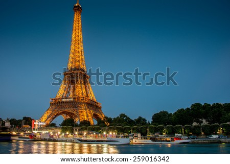 PARIS - JULY 12, 2013: Eiffel Tower on July 12, 2013 in Paris. Eiffel tower is one the most popular attractions in Paris - stock photo