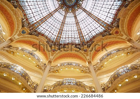 PARIS - JULY 8: Galeries Lafayette dome, interior in Paris. The architect Georges Chedanne designed the store where a Art Nouveau glass and steel dome was finished in 1912, on July 8, 2014 in Paris. - stock photo