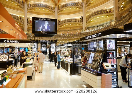 PARIS - JULY 8: Galeries Lafayette interior in Paris. The architect Georges Chedanne designed the store where a Art Nouveau glass and steel dome was finished in 1912, on July 8, 2014 in Paris. - stock photo