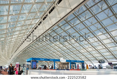 PARIS - 24 JULY 2014: Interior view of Charles de Gaulle airport, july 24, 2014, Paris, France. Airport is one of largest airports in Europe. Named in honor of Charles de Gaulle, President of France. - stock photo