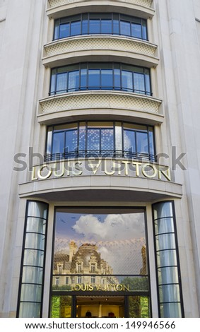 PARIS - JULY 28: Louis Vuitton store on July 28, 2013 in Paris France. This store is located on the Champs Elys�©es and offers a wide range of luxury Louis Vuitton clothes and accessories - stock photo