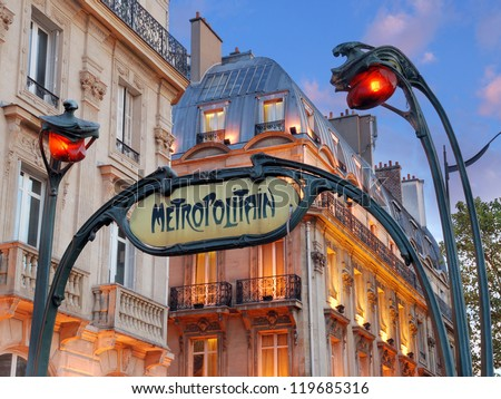 PARIS - JULY 20: Metropolitain sign Saint-Michel Metro Station on July 20, 2012 in Paris, France. The Station is located in the centre of Paris and named after the Boulevard Saint-Michel. - stock photo