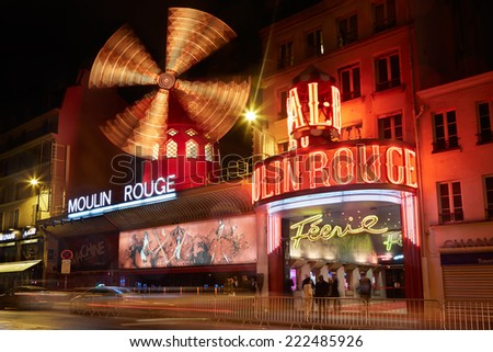 PARIS - JULY 11: Moulin Rouge by night in Paris. The cabaret was founded in 1889, famous for the can can dance show, on July 11th, 2014 in Paris, France. - stock photo
