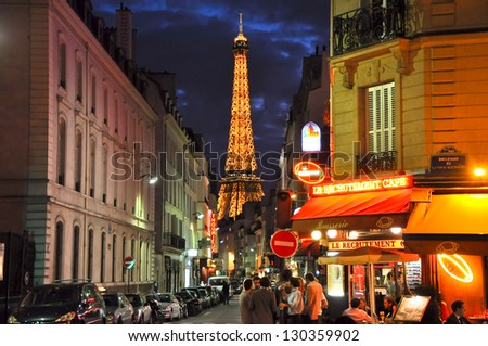 PARIS-JULY 9: Paris with the Eiffel Tower in the background on July 9, 2009 in Paris. Paris is the capital and largest city of France. It is situated on the river Seine, at the Ã?Â?le-de-France region. - stock photo