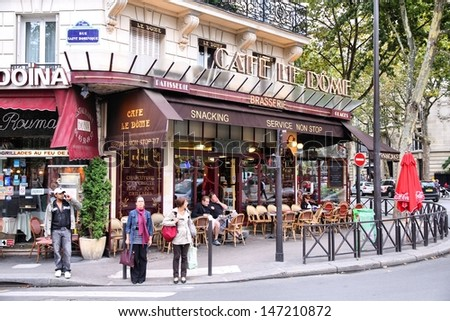 PARIS - JULY 21: People visit Cafe Le Dome on July 21, 2011 in Paris, France. Le Dome cafe is a typical establishment for Paris, one of largest metropolitan areas in Europe. - stock photo