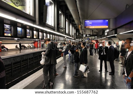 PARIS - JULY 20: People wait at Metro station on July 20, 2011 in Paris, France. Paris Metro is the 2nd largest underground system worldwide by number of stations (300).