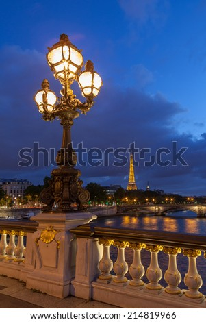 PARIS - JULY 13: The Eiffel Tower, viewed from Pont Alexandre lll, in Paris, France on July 13,2014. The tower is illuminated at night by 20,000 lights.