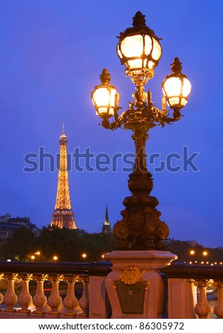 PARIS - JULY 16: The Eiffel Tower, viewed from Pont Alexandre lll, in Paris, France on July 16, 2011 is illuminated at night by 20,000 lights.
