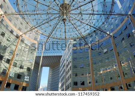 PARIS - JULY 30: The office building in La Defense on July 30, 2012 in Paris, France. La Defense is a major business district of the Paris, France. - stock photo