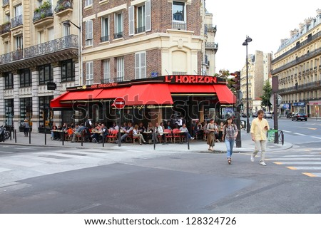 PARIS - JULY 24: Tourists eat at L'Horizon restaurant on July 24, 2011 in Paris, France. Paris is the most visited city in the world with 15.6 million international arrivals in 2011. - stock photo