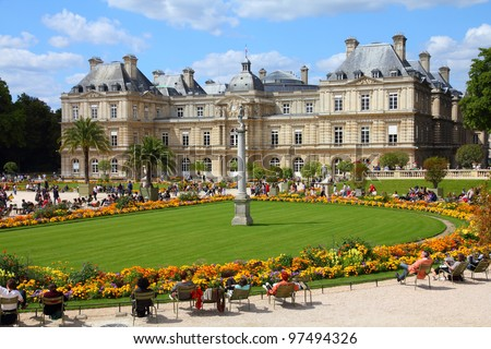 PARIS - JULY 24: Tourists relax in Luxembourg Gardens on July 24, 2011 in Paris, France. Luxembourg area is popular among tourists in Paris, the most visited city worldwide. - stock photo