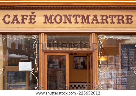 PARIS - JULY 9: Typical Cafe in Montmartre, Paris near Sacre Coeur. Montmartre is a 130 metros high hill known for its night clubs and artists studios on July 9, 2014 in Paris. - stock photo