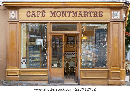 PARIS - JULY 9: Typical wooden Cafe in Montmartre. Montmartre is a 130 metros high hill known for its night clubs and artists studios on July 9, 2014 in Paris. - stock photo