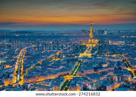 Paris - Jun 19: Aerial view of Eiffel Tower Light and Beam Performance Show at Dusk on Jun 19, 2014. Eiffel Tower is the highest monument in France use 20,000 light bulbs in the show.  - stock photo