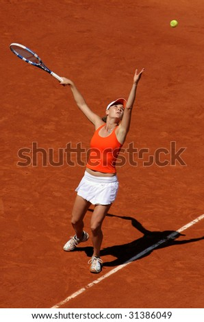 PARIS - JUNE 1: Agnieszka Radwanska of Poland serves at French Open, Roland Garros on June 1, 2009 in Paris, France. - stock photo