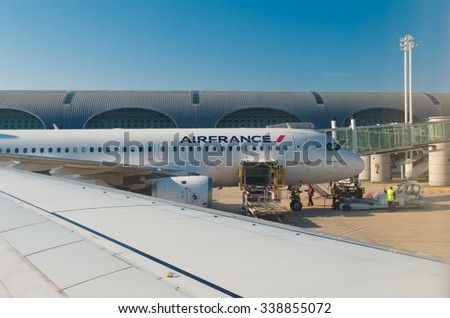 PARIS - JUNE 11, 2015: Airfrance plane at the Roissy Charles de Gaulle International Airport (CDG). In 2013, the airport handled 62,052,917 passengers and 497,763 aircraft movements - stock photo