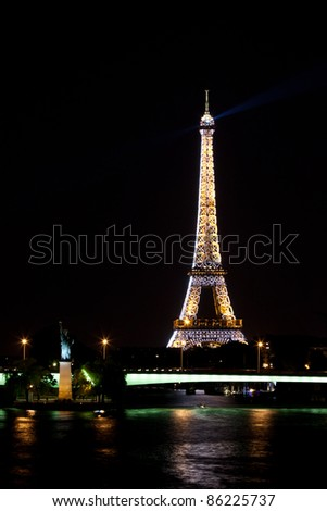 PARIS - JUNE 2: Eiffel Tower at night on June 2, 2011 in Paris. The Eiffel tower is the most visited monument of France with about 6 million visitors every year. - stock photo