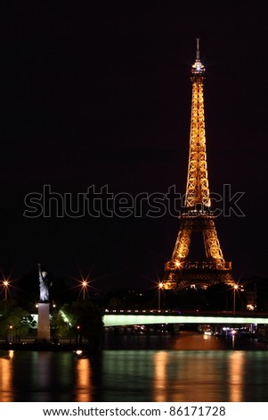 PARIS - JUNE 11: Eiffel Tower at night on June 11, 2011. The Eiffel tower is the most visited monument of France with about 6 million visitors every year. - stock photo