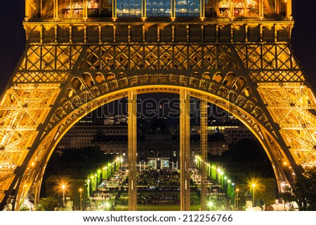 PARIS - JUNE 21: Eiffel Tower brightly illuminated at dusk on JUNE 21, 2014 in Paris. The Eiffel tower is the most visited monument of France. - stock photo