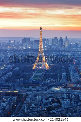 PARIS -JUNE 22: Eiffel Tower brightly illuminated at dusk on June 22, 2013 in Paris. The Eiffel tower is the most visited monument of France.