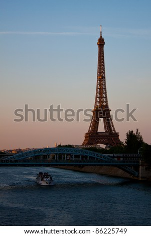 PARIS - JUNE 2: Eiffel Tower illuminated at sunset on June 2, 2011 in Paris. The Eiffel tower is the most visited monument of France with about 6 million visitors every year. - stock photo