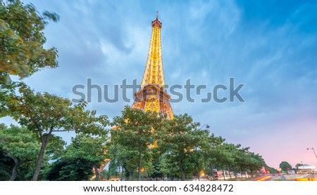 PARIS - JUNE 11, 2014: Illuminated Eiffel Tower at night. La Tour Eiffel is the most visited landmark in France.
