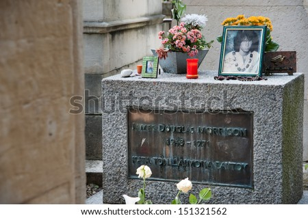 PARIS - JUNE 25: Jim Morrison's grave, Pere Lachaise Cemetery, Paris, France, June 25, 2013. - stock photo