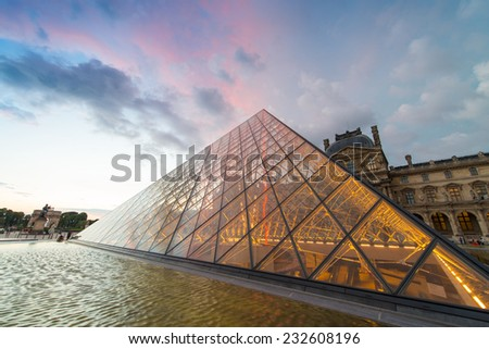 PARIS - JUNE 15 : Louvre museum at twilight in summer on June 15, 2014. Louvre museum is one of the world's largest museums with more than 8 million visitors each year - stock photo