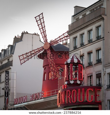 PARIS - JUNE 17, 2004: The Moulin Rouge at sunset, on June 17, 2004 in Paris, France. Moulin Rouge is a famous cabaret built in 1889, locating in the Paris red-light district of Pigalle. - stock photo