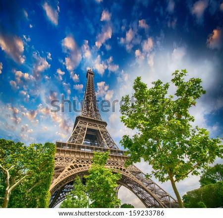 Paris, La Tour Eiffel. Tower view from Champs de Mars garden at summer sunset. - stock photo