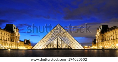 PARIS - MAR 2: External night view of the Louvre Museum (Musee du Louvre) on March 2, 2014 in Paris, France. - stock photo