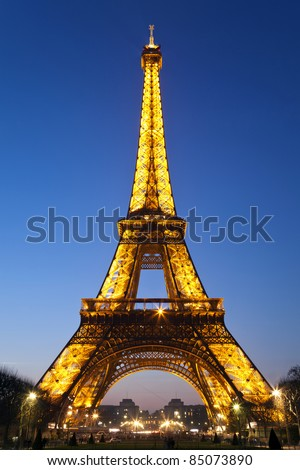 PARIS - MARCH 24: Lighting the Eiffel Tower on March 24, 2011 in Paris.  Established in 1985, the new system gives the a golden glow at night.