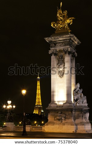 PARIS - MARCH 27: Night illumination on the bridge of Alexander III and the Eiffel Tower on March 27, 2011 in Paris. This illumination admire 25,000,000 tourists a year. - stock photo