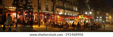 PARIS - MARCH 14: Panoramic photo of several typical parisian cafes in front of the Sorbonne University (Place de la Sorbonne) by night on March 14, 2014 in Paris, France. - stock photo