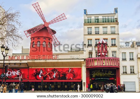 PARIS - MARCH 21, 2015: The cabaret  Moulin Rouge in Paris, France. Moulin Rouge is a famous cabaret built in 1889, locating in the Paris red-light district of Pigalle. - stock photo
