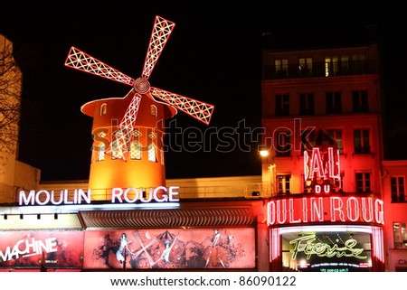 PARIS – MARCH 13: The Moulin Rouge at night on March 13, 2011. The Moulin Rouge is a famous cabaret in Paris, built in 1889 and located in the red light district of Pigalle.