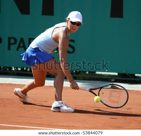 PARIS - MAY 20: Arina RODIONOVA of Russia plays the 2nd round qualification match at French Open, Roland Garros on May 20, 2010 in Paris, France. - stock photo