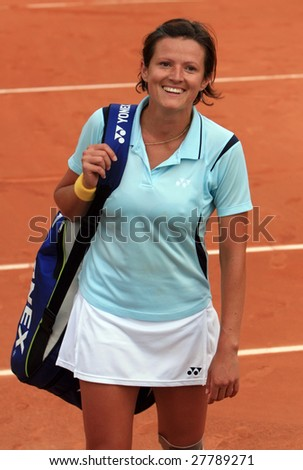 PARIS - MAY 22: Bosnia and Herzegovina's professional tennis player Sandra Martinovic smiles after her match at French Open, Roland Garros on May 22, 2008 in Paris, France. - stock photo