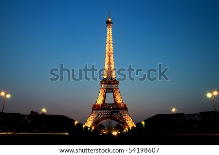 PARIS - MAY 20 : Eiffel tower at night on May 20, 2010 in Paris. The Eiffel tower is the most visited monument of France. - stock photo