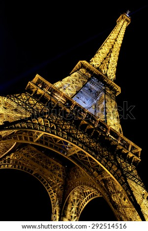 PARIS - MAY 27, 2015: Eiffel Tower brightly illuminated at dusk on May 27, 2015 in Paris. The Eiffel tower is the most visited monument of France. - stock photo