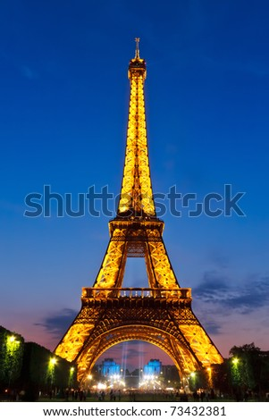 PARIS - MAY 28: Eiffel Tower brightly illuminated at dusk on May 28, 2008 in Paris. The Eiffel tower is is the tallest monument in Paris and the most-visited in France.