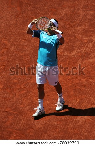 PARIS - MAY 23: Feliciano Lopez of Spain checks his racquet during the 1st round match  at French Open, Roland Garros on May 23, 2011 in Paris, France. - stock photo