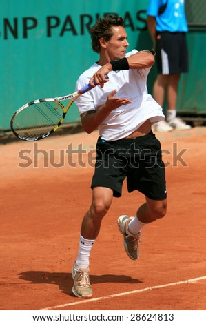 PARIS - MAY 23: French professional tennis player Nicolas Devilder during the match at French Open, Roland Garros on May 23, 2008 in Paris, France. - stock photo