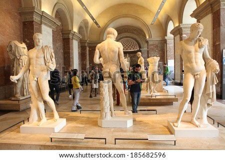 PARIS - MAY 3: In the Louvre Museum, May 3, 2013 in Paris, France. Louvre is the biggest Museum in Paris displayed over 60,000 sq.M. of exhibition space and very popular culture site in the world - stock photo