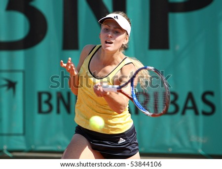 PARIS - MAY 20: Ksenia PERVAK of Russia plays the 2nd round qualification match at French Open, Roland Garros on May 20, 2010 in Paris, France. - stock photo