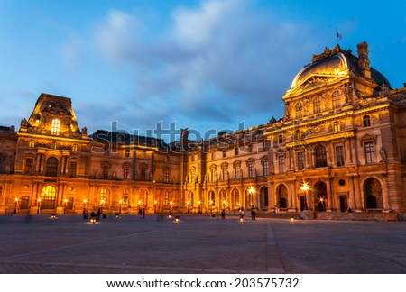 PARIS - MAY 10 : Louvre museum at twilight in summer on May 10,2014. Louvre museum is one of the world's largest museums